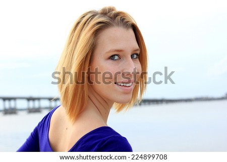 Professional Attractive Blonde Smiling Young College Student Water Outside Looking Back Happy - stock photo