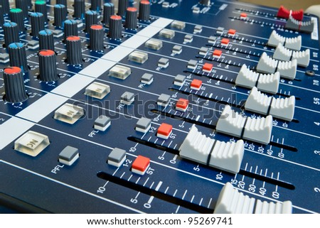 professional audio mixer with shallow depth of field - stock photo