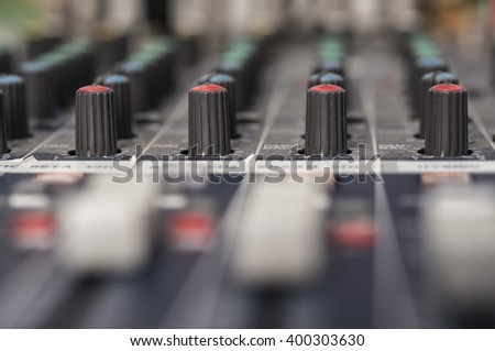 Professional audio mixing console with faders