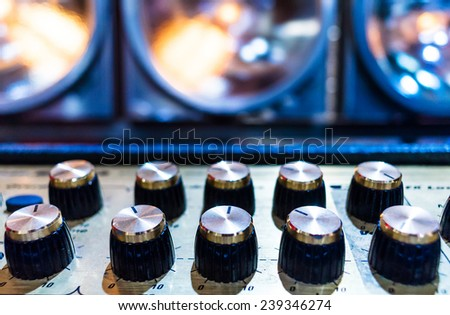 Professional audio sound equipment with buttons and sliders .  Selective focus. A little of DOF.  - stock photo