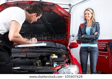 Professional auto mechanic and  a client woman. - stock photo