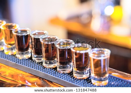 professional barman in action making drink shots - stock photo