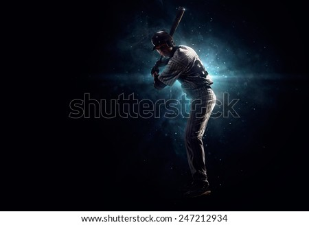 Professional baseball player  is tanding in the spotlight - stock photo