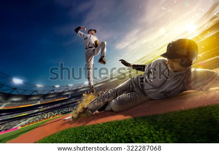 Professional baseball players on the grand arena - stock photo