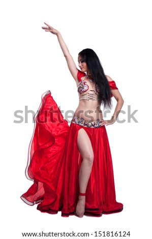 professional belly dancer on white background in red costume