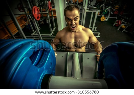 Professional bodybuilder in a sport gym club. Sports. Healthy lifestyle. - stock photo