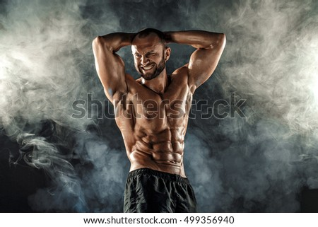 Professional bodybuilder posing with arms on head