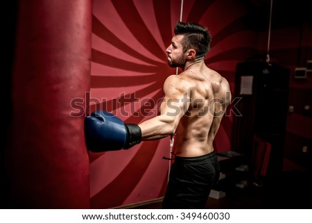 professional boxer fighting and training in gym. Strong, muscular man training and boxing - stock photo