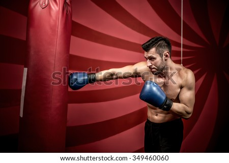 professional boxing training with muscular athletic man. Active boxer in gym - stock photo