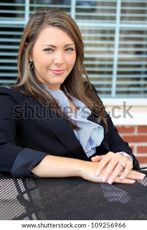 Professional Brunette Business Woman Smiling Arms Sitting Down