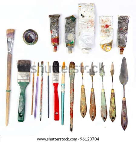professional brushes with a palette knife and tubes of paint isolated on a white background - stock photo