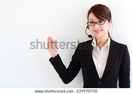 Professional business lady in a headset gives a presentation