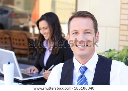 Professional Business Man and Woman Businesswoman Businessman Smiling and Looking at the Camera Happy and Helpful - stock photo