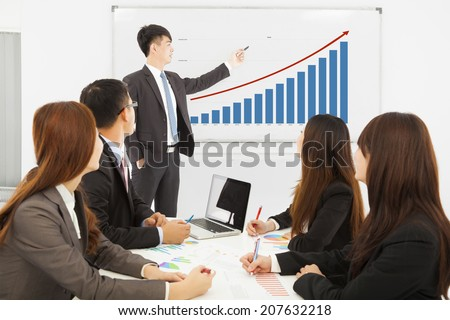 professional business man showing a market situation chart - stock photo