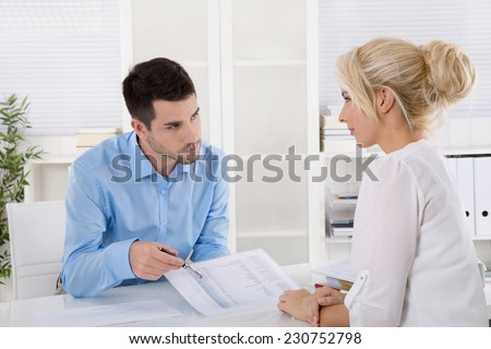 Professional business meeting: consultant explain his female customer the risk and possibilities of provision for one's old age. - stock photo