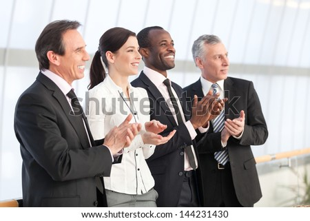 Professional business team applauding - stock photo