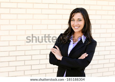 Professional Business Woman Confident Arms Crossed Wearing Suit