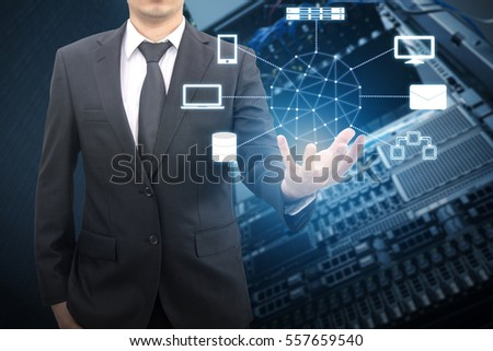 Professional businessman connecting network on hand in Cloud technology with datacenter server and storage background, communication and business concept