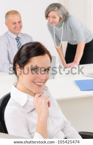 Professional businesswoman attractive sitting by office desk