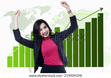 Professional businesswoman smiling happy in front of business chart - stock photo