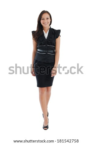 Professional businesswoman walking confident in skirt suit isolated on white background. - stock photo