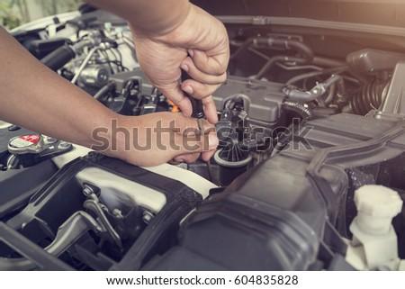 Professional car mechanic working in auto repair service