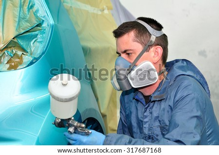 Professional car painting by master painter. - stock photo