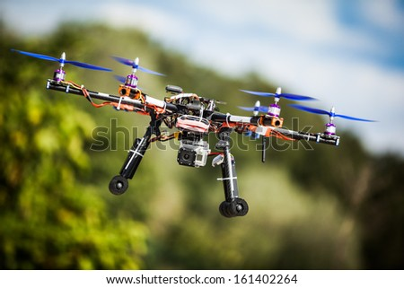 Professional carbon drone with GPS making a ride. - stock photo