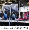 Professional carpet cleaning service hose and water pump running from van - stock photo