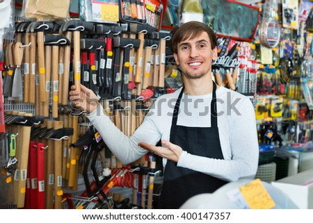 Professional  cheerful friendly salesman working and smiling in building store