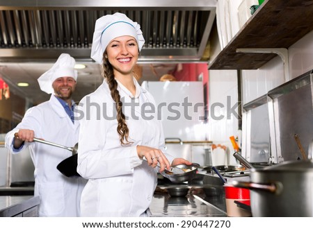 Professional  chef and cook  working at take-away restaurant kitchen - stock photo