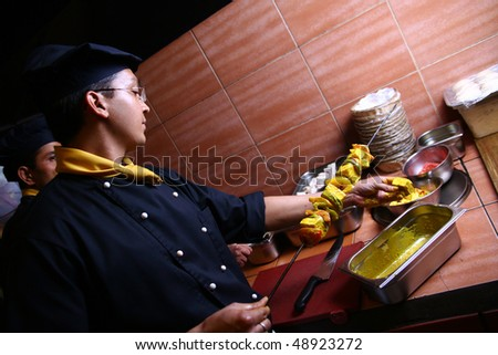 professional chef man doing meat food - stock photo