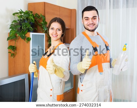 Professional cleaners cleaning in room - stock photo