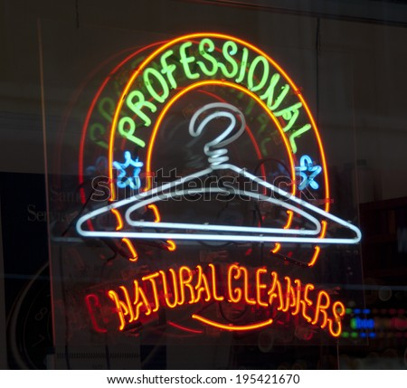 Professional cleaners neon sign in New York City Store window - stock photo