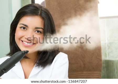 professional cleaning lady at her work, with steam machine, logos removed