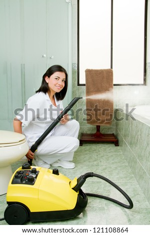 Professional cleaning lady clean bathrooom. - stock photo