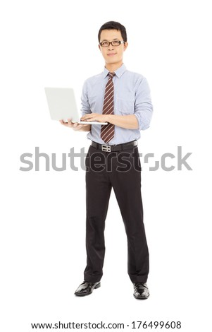 professional computer engineer standing and holding the laptop  - stock photo