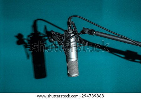 Professional condenser studio microphone with shadow, Musical Concept