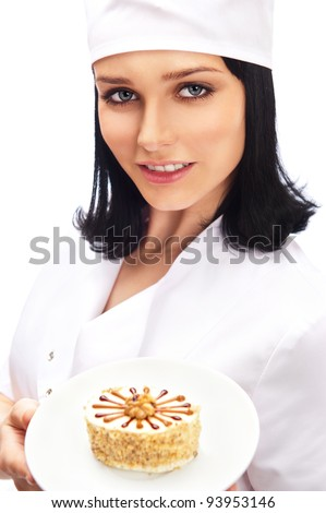 Professional Cook with cute cake on white plate, isolated on white background