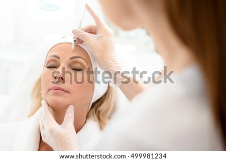 Professional cosmetician making rejuvenate injection