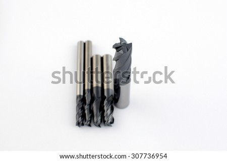 Professional cutting tools. Few metallic carbide endmills, different size used for metalwork.  - stock photo