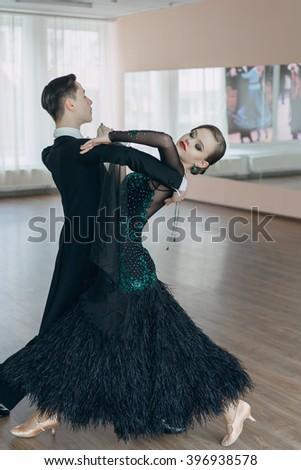 Professional dancers dancing in ballroom - stock photo