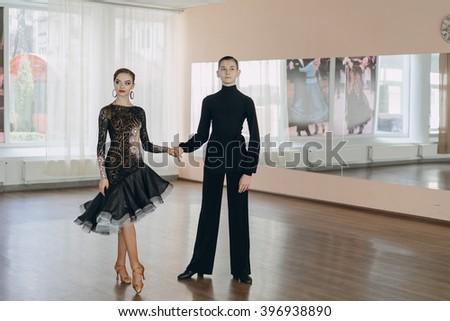Professional dancers dancing in ballroom. Latin.  - stock photo
