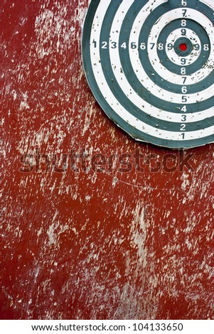 Professional dart board on red - stock photo