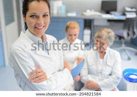 Professional dentist woman looking camera senior patient dental  assistant surgery - stock photo