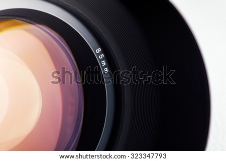 Professional digital camera lens close up on white background