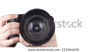 professional digital photo camera with woman hand isolated on white - stock photo