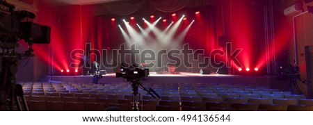 Professional digital video camera. accessories for 4k video cameras. tv camera in a concert hall.