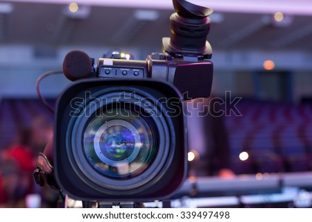Professional digital video camera. tv camera in a concert hal.  Digital TV camera - stock photo