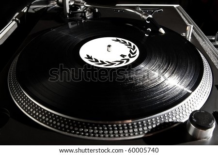 Professional Dj turntable record player playing vinyl disc with music.Analog audio equipment for disc jockey,party,concert.Hip hop dj scratch vinyl records.Turntables needle in focus.Black music disc
